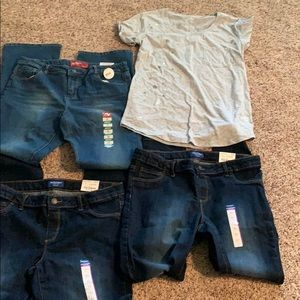 Selling teenage girls jeans and shirt.